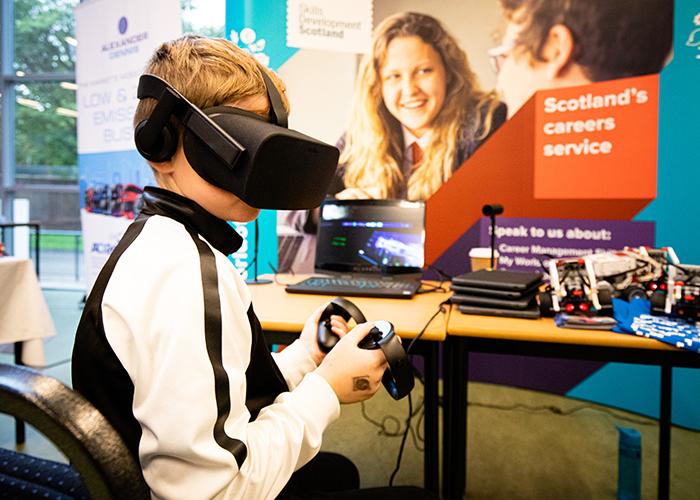 Boy wearing VR headset